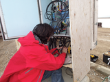 Ryan Key servicing instruments in Cambridge Bay