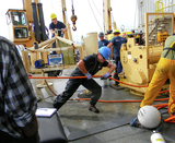 Hauling the umbilical cable onto the deck