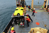 Pulling the ROV onto the deck