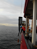 Akash Sastri oversees a plankton tow operation near Entrance
