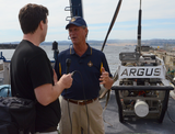 Dr. Bob Ballard speaks to reporters on the E/V Nautilus